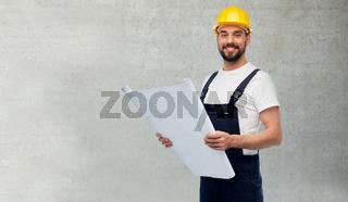 male worker or builder in helmet with blueprint