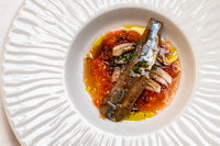 A plate of marinated sardines at seafood restaurant
