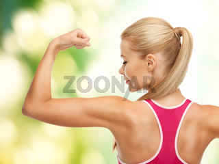 sporty woman showing her biceps