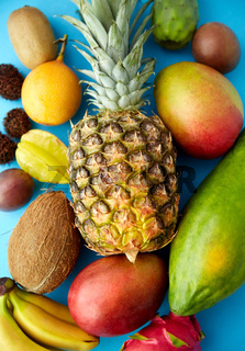 many different exotic fruits on blue background
