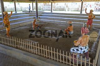 Darstellung des traditionellen Hahnenkampfes im Tempel Pura Tama