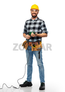 happy male worker or builder in helmet with drill