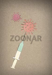 Corona Virus Impfung mit Spritze - Scherenschnitt aus Papier