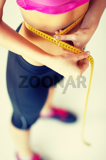 trained belly with measuring tape