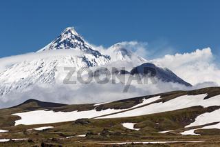 Beautiful mountain landscape of Kamchatka Peninsula, view of active volcanoes