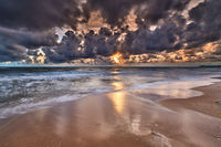 colorful sunrise on beach of baltic sea in germany