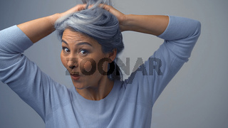 Beautiful Middle-Aged Woman Is Having Fun And Grimacing