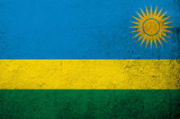 the Republic of Rwanda National flag. Grunge background