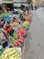 Hanoi, Vietnam - February 26, 2020: fresh fruits and vegetables street sellers in Hanoi