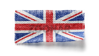 United Kingdom flag on a piece of cloth on a white background