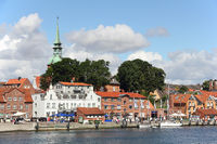 Waterside panorama of Kappeln and  steeple of St. Nikolai church