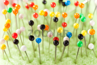 Close-up view of many colored pins