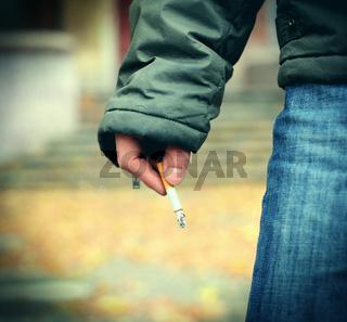 Cigarette in a Hand