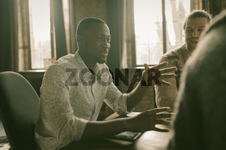 Happy african Guy attending Business meeting