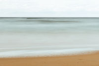 Long exposure view of sandy beach in Spain