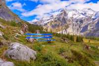Blue bench near Oeschinnensee lake, Switzerland
