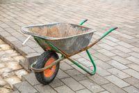Old gray household wheel barrow