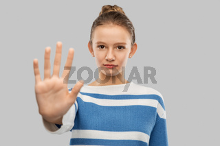 teenage girl making stopping gesture