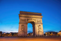 Paris France night city skyline at Arc de Triomphe and Champs Elysees