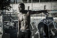 Hot buff young black man posing outdoor
