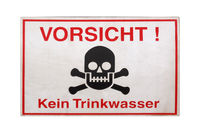 German sign isolated over white. Attention, no drinking water.