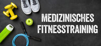 Fitness equipment on a dark background - Medical fitness training - Medizinisches Fitnesstraining (German)
