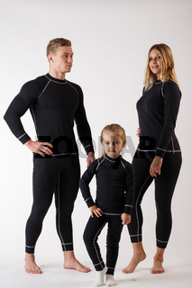 Family in thermal underwear on a white background. Sportswear.