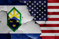 flags of Colorado Springs and USA painted on cracked wall