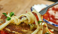 Pan fried sea bass with pesto spaghetti