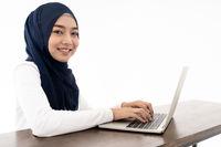 Muslim girl using laptop