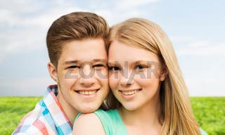 smiling couple hugging over natural background
