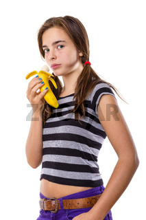 teenage girl eating a banana, isolated on white