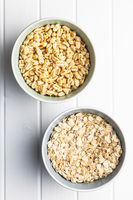 Puffed wheat covered with honey and oatmeals in bowls.