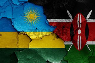 flags of Rwanda and Kenya painted on cracked wall