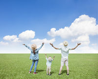 happy  family standing on the grass and watching  cloud  background
