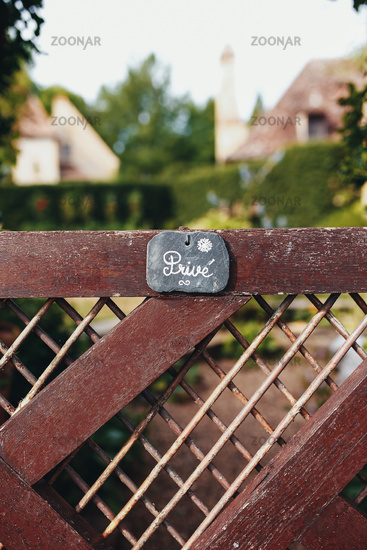 Fence of private house with private badge