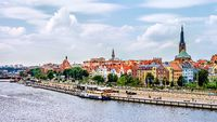 Ships anchored on Odra River pier, Piastowski Boulevard. Cathedral Basilica of St James the Apostle