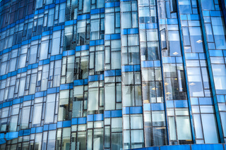 blue glass modern building closeup