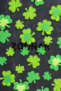 Green Clovers on Chalkboard Background Background for St. Patrick's Day Holiday
