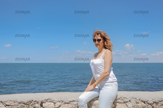 Attractive middle aged woman enjoying happy retirement with holiday at beach