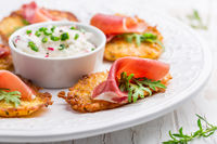 Potato pancake with prosciutto and dip of radishes cream cheese and chives. Healthy food concept.