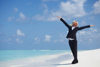 Business woman on ocean coast