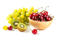 Grapes, cherry and kiwi in the bowls