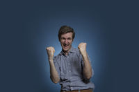 Man with Arms Raised in Gesture of Happiness
