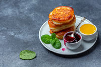 Traditional pancakes with jam and honey.