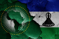 flags of African Union and Lesotho painted on cracked wall