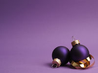 Purple crocus in the city vintage Christmas baubles on a purple background