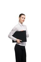Young businesswoman with laptop looking at camera