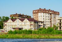 Buildings of mini hotels on the river bank in the Adler resort area