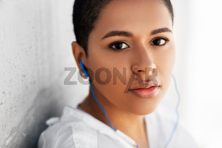 african american woman with earphones